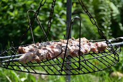 Shashlik baking. Shashlik (meaning skewered meat) was originally made of lamb. Nowadays it is also made of pork or beef depending on local preferences and Stock Image
