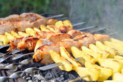 Shashlik - cooking barbecue Royalty Free Stock Images