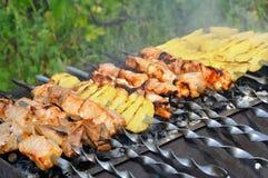 Shashlik - cooking barbecue Royalty Free Stock Photos