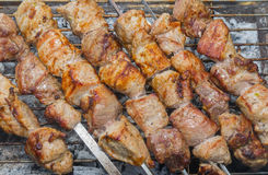 Shashlik - Georgian meal with meat cooked outdoor Royalty Free Stock Images