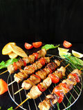 Shashlik made of meat with vegetables Stock Images