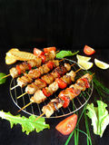 Shashlik made of meat with vegetables Stock Photography