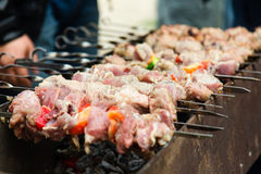 Shashlik, meat grilling on metal skewer, close up Royalty Free Stock Photos