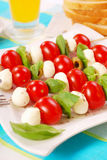 Shashlik with mozzarella,tomatoes and olives Royalty Free Stock Image