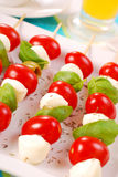 Shashlik with mozzarella,tomatoes and olives Stock Photos