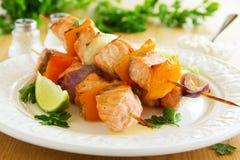 Shashlik of salmon with vegetables Stock Image