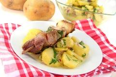 Shashlik skewer with potato salad Stock Photo