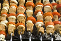 Shashlik and tomatos Stock Images