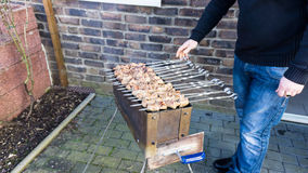Shashlik  - traditional russian barbecue.  meat on barbeque. smo Royalty Free Stock Image