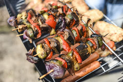 Shashlik from vegetables on grill, outdoor, summer time. Royalty Free Stock Images