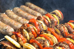 Shashlik and white sausage Royalty Free Stock Photo