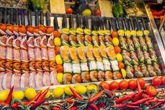 Shashliks with salmon, beef fillet,  cheese, lemon, onion, etc. Royalty Free Stock Photography