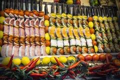 Shashliks with salmon, beef fillet,  cheese, lemon, onion, papri Stock Images