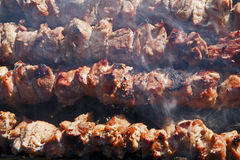 Shashlyk. Meat kebabs shashlyk and mushrooms on a barbecue, perfect for summer spring season bbq Royalty Free Stock Photography