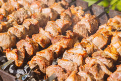 Shashlyk (kebab) grilling on the bbq, vintage style Royalty Free Stock Photos