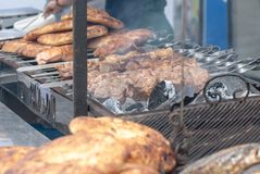 Grilled meat, shish kebab and pita bread on the grill close-up royalty free stock photos