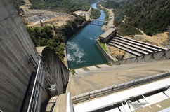 Shasta Hydro Dam and Spillway, USA. A view of an arch type concrete hydro electric dam located in the USA Royalty Free Stock Photography