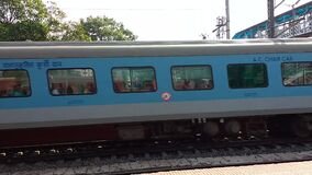Shatabdi Express -12041  Howrah Junction to New Jalpaiguri  High speed Indian train running on railroad track in a Suburban