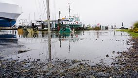 Shattemuck Yacht Club unusually high tide in Nor`Easter royalty free stock image