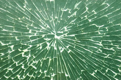 Shattered. Glass radiates from a direct hit Royalty Free Stock Photography