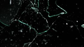 Shattered and broken glass pieces isolated on black.  royalty free stock image