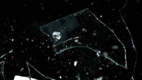 Shattered and broken glass pieces isolated on black.  Stock Image