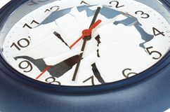 Shattered clock. Round wall clock with a cracked dial Stock Photos