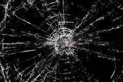 Shattered glass. Shattered piece of cracking broken glass royalty free stock photos