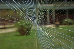 Shattered Glass. With a lawn and building behind (landscape orientation Stock Photos