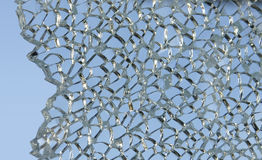 Shattered glass against sky Stock Photos