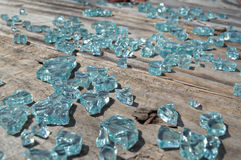 Shattered Glass. Broken window spills out onto the deck Royalty Free Stock Photos