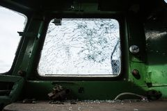 Shattered glass in cabine of old locomotive Stock Image