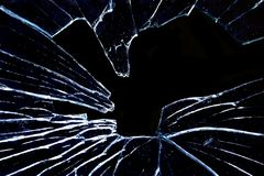 Shattered glass on jet black stock photo