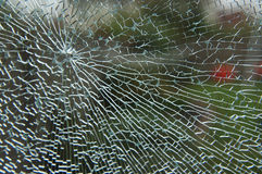 Shattered Glass Pane. Shattered sheet of Glass close up Stock Photos