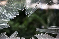 Shattered glass window. With sharp edges Stock Photos