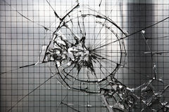 Shattered glass window. Shattered and cracked reinforced glass window stock photos