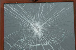 Shattered glass window. Pane in wooden frame Stock Photos