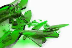 Shattered green glass. On white stock image