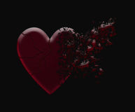 Shattered heart. Exploding heart isolated in a black background Stock Photo