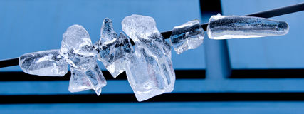 Shattered icicle on a wire. In winter Royalty Free Stock Images