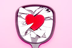 Shattered Love. Heart on broken mirror for concept of a broken relationship or marriage Stock Photos