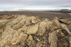 Shattered Rocks on a Polar Desert Island. The polar desert at Kloverbladbukta in Nordaustlandet, Svalbard in Norwegian Arctic. Most of the rocks on the island Royalty Free Stock Images