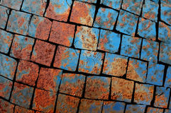Shattered rusty metal texture Stock Photos