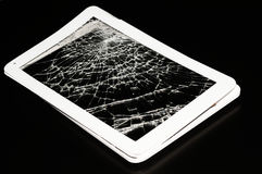 Shattered white pad, on black Royalty Free Stock Images