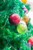 Shatterproof ball ornament on Christmas Tree Stock Photos