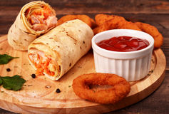 Shaurma with chicken with breaded onion rings Royalty Free Stock Images