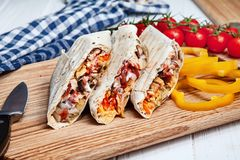 Close up view on delicious cuted shaurma or shawerma on board on white background. stock photos
