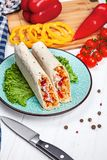 Close up view on delicious cuted shaurma or shawerma on board on white background. stock photo