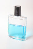 After Shave. A blue after shave with isolated background Royalty Free Stock Photos