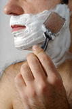 Shave. Face with shaving foam and a razor Stock Photo